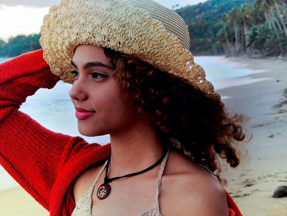 Lifestyles Young Women Beautiful Woman Knit Hat Beach Relaxing Freedom Beauty Enjoying Life Curly Hair What A Beautiful Day Everyday Lives Water Nature Free Beautiful Beauty In Nature Model Professional Hat What A Wonderful World Happiness Sunshine Island Leisure Activity