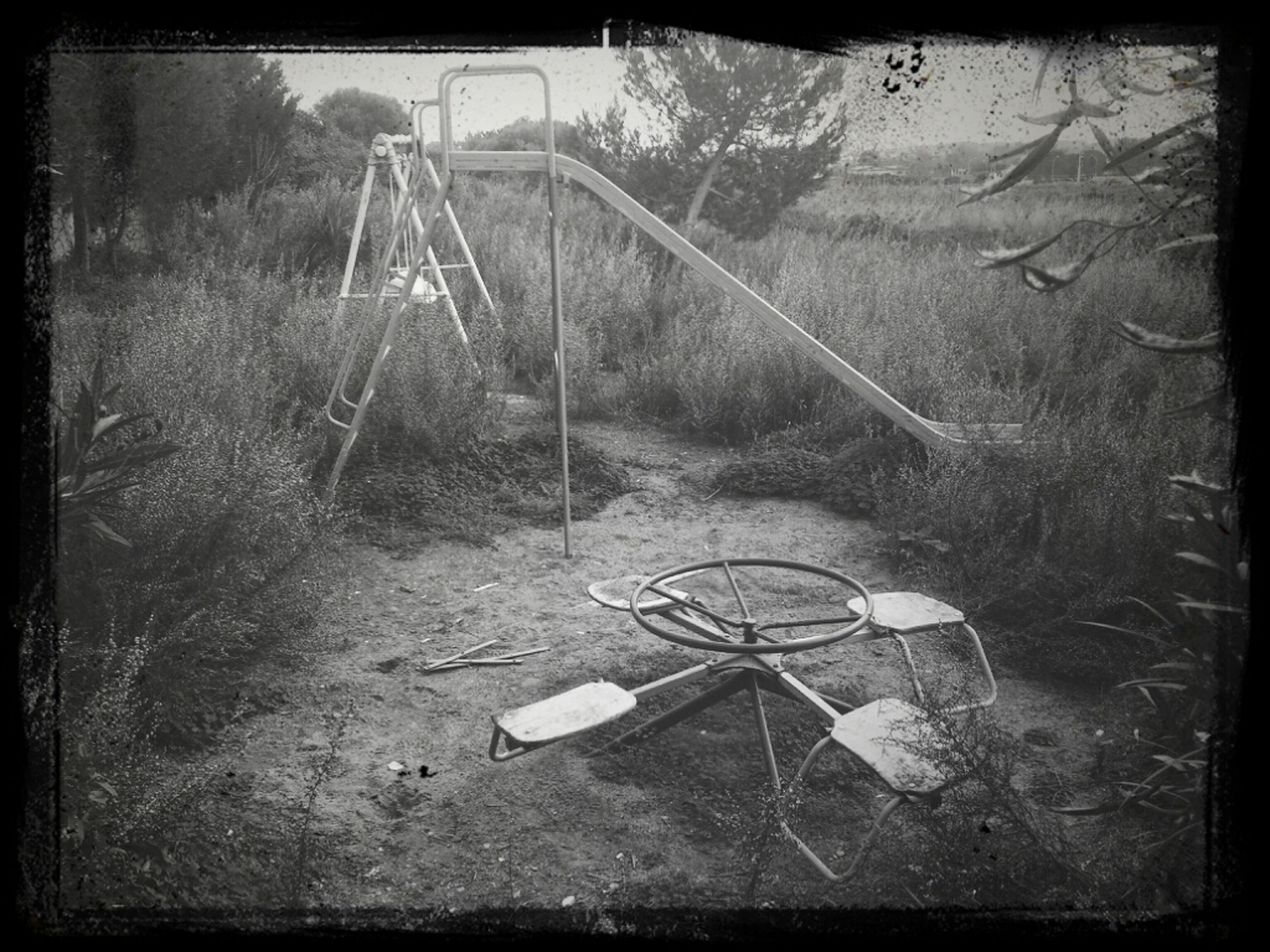 transfer print, auto post production filter, abandoned, tree, grass, damaged, outdoors, obsolete, transportation, day, no people, field, high angle view, plant, nature, vignette, old, absence, broken, tranquility