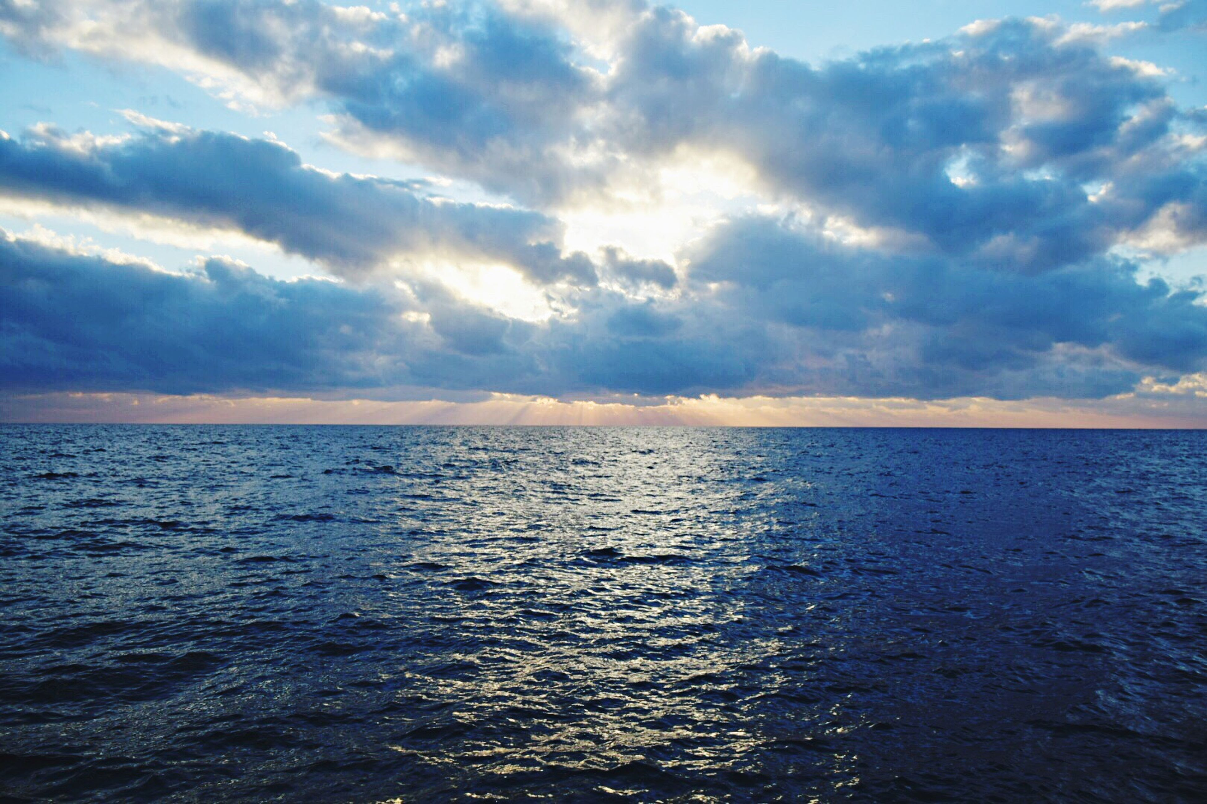 sea, beauty in nature, reflection, scenics, cloud - sky, sunset, horizon over water, water, sky, nature, no people, outdoors, dramatic sky, tranquility, day