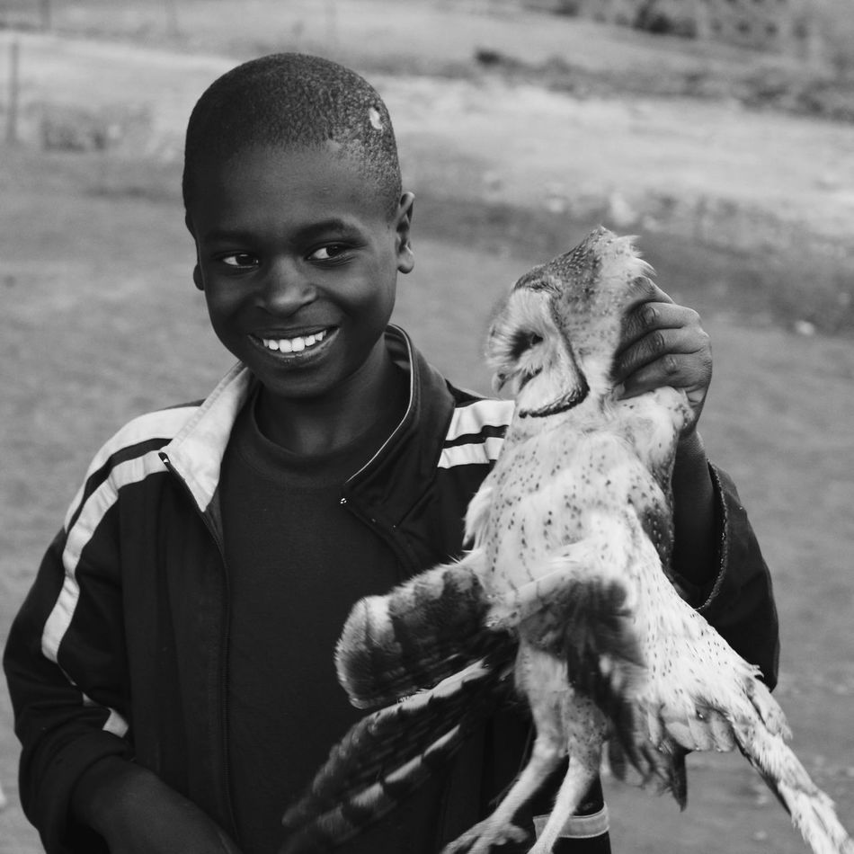 Africa African Boys Childhood DifferentLife Extraordinary  Happiness Haunted Haunting  Iringa Monochrome Murder One Animal One Person Outdoors Owl Play Portrait Real People Smile Teeth Toothy Smile Uncommon