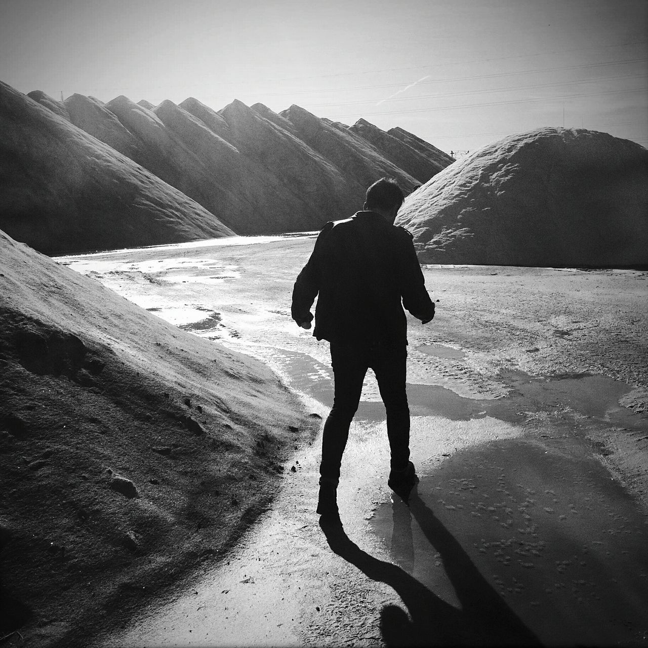 Man On The Moon Blackandwhite Salt Salt Works Shadow Real People Walking Alone... Treading Back View Go Away People Outdoors Landscape White Shine Shillouette Finding New Frontiers