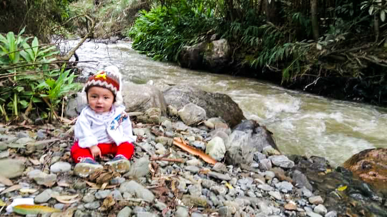 Done That. Childhood Child Children Only River Outdoors People Waterfall Nature Day Water Beautiful One Boy Only Cute Beauty In Nature Lovely Best Place To Visit South America Ecuador Best Of EyeEm Bestoftheday Photography Ecosystem  Tranquility Beauty In Nature