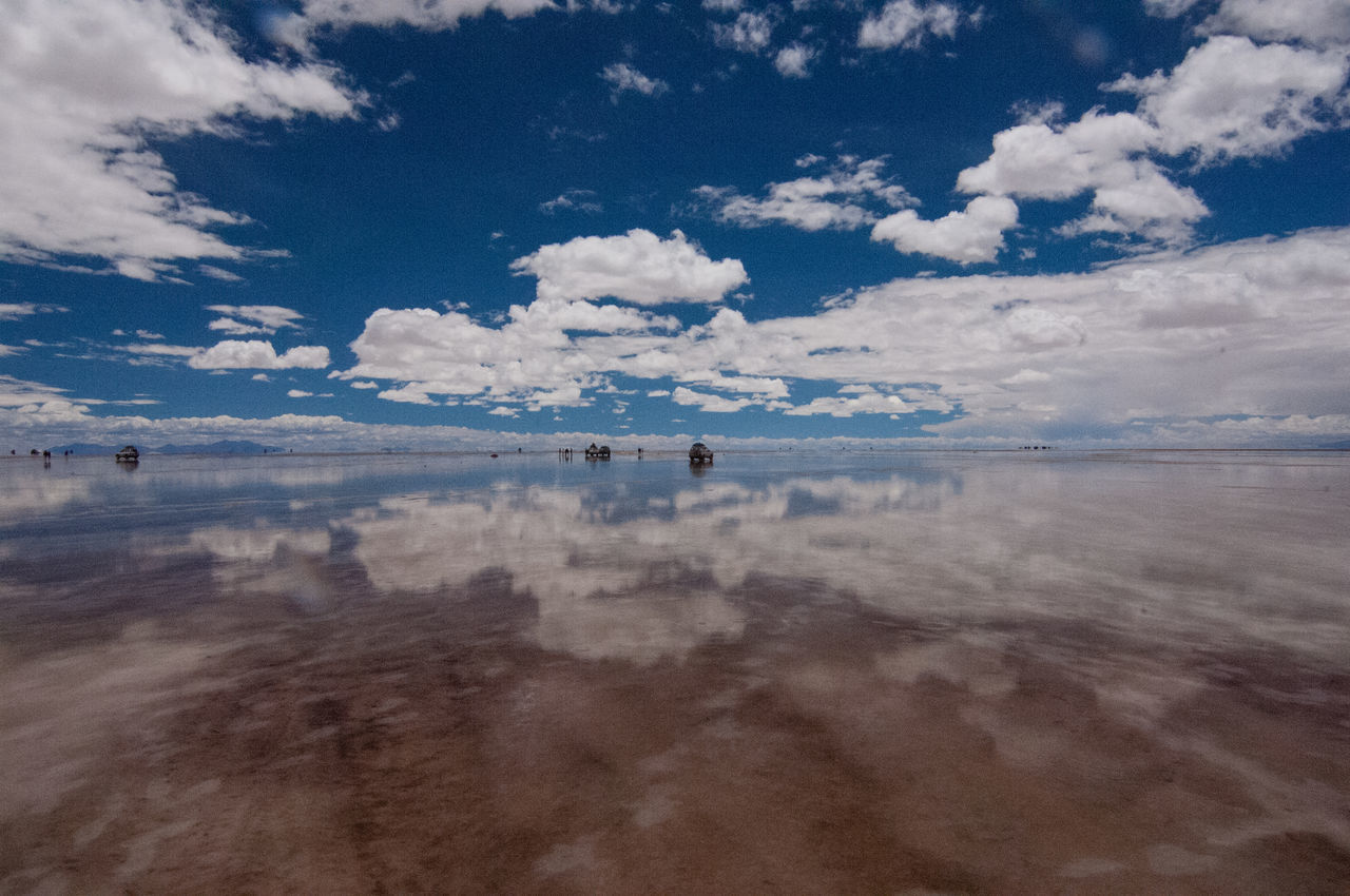Scenic View Of Sea With Clouds Reflection