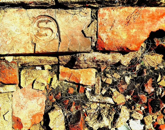 Backgrounds Full Frame Textured  Detail Stone Material Close-up Damaged Outdoors Day Extreme Close Up No People Weathered Patterned Bricks Brickstones Bricks And Stones Brickswork Bricks And Mortar Brickporn Distressed Distressed FX Distressed Look No Filter