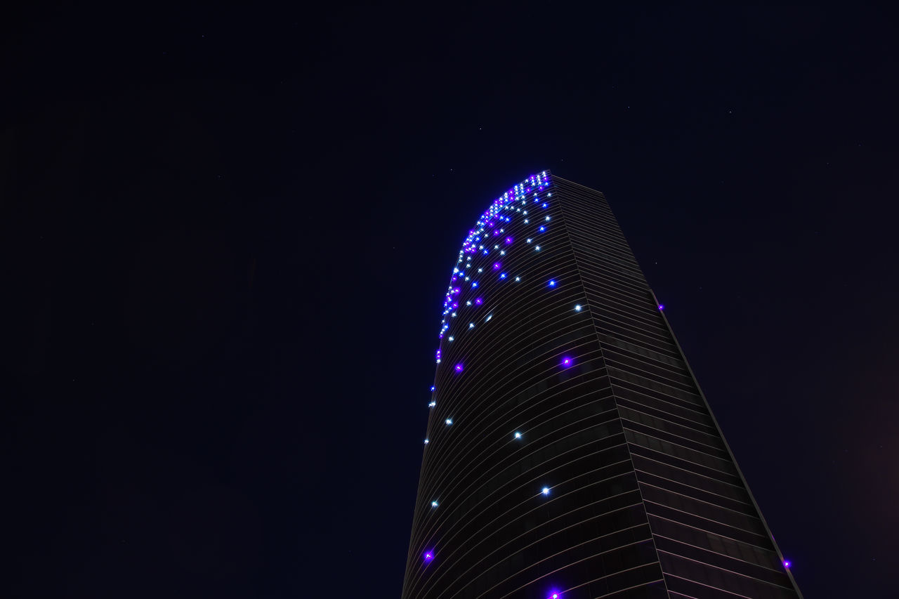 night, illuminated, modern, architecture, low angle view, travel destinations, built structure, skyscraper, building exterior, no people, outdoors, clear sky, city, sky