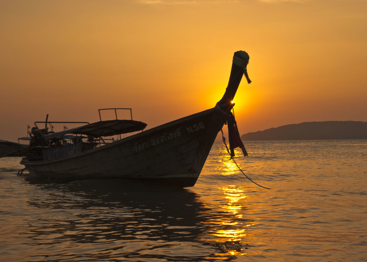 sunset, transportation, nautical vessel, orange color, water, mode of transport, nature, beauty in nature, silhouette, scenics, sea, sky, waterfront, outdoors, men, tranquility, longtail boat, real people, one person, people