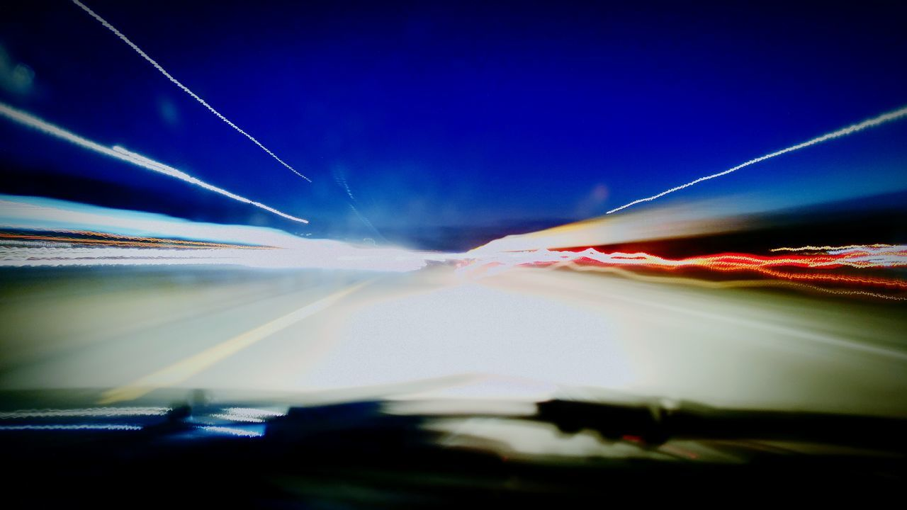 speed, light trail, motion, long exposure, blurred motion, night, illuminated, no people, outdoors, blue, clear sky, sky, nature
