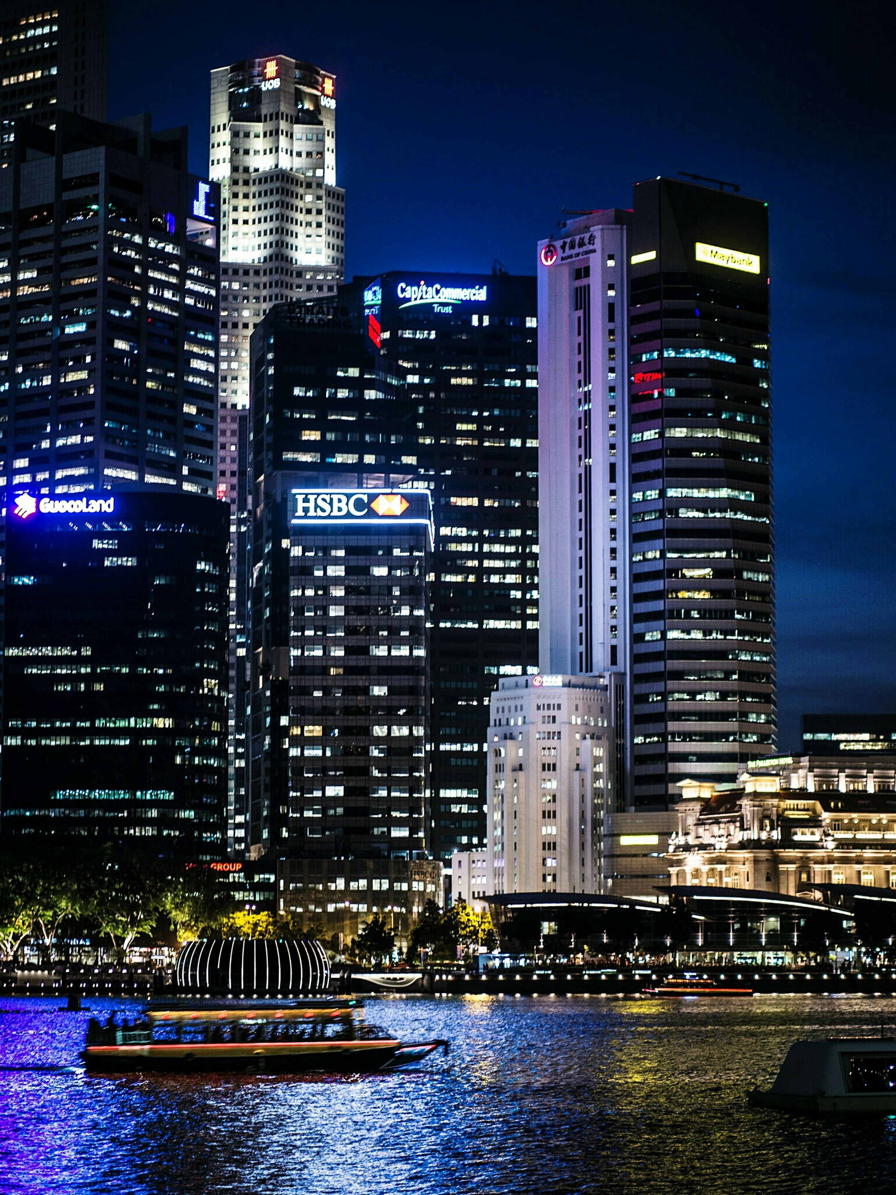 building exterior, skyscraper, city, architecture, built structure, waterfront, tall - high, modern, illuminated, office building, water, tower, urban skyline, cityscape, financial district, river, night, boat, city life, capital cities, skyline, travel destinations, tall, building, sky, outdoors, development, tourism, blue, no people