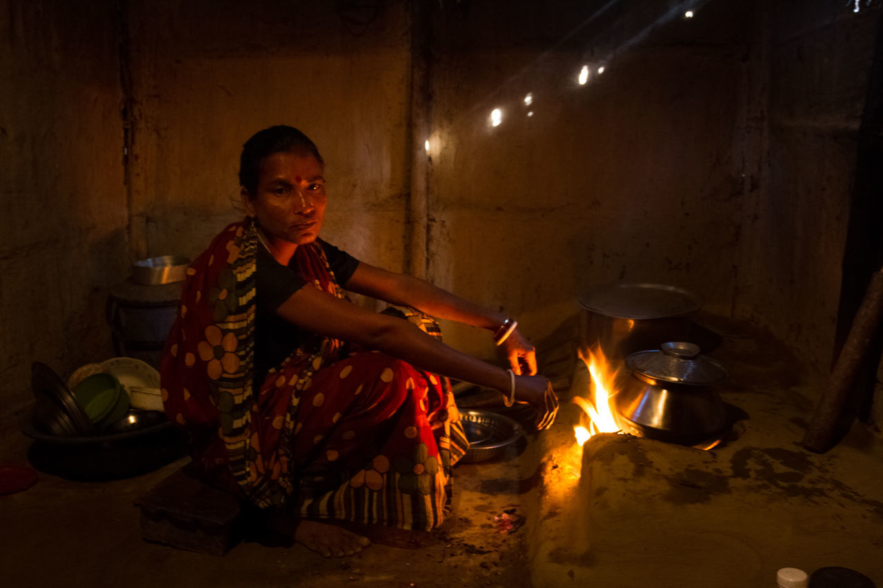 A woman was cooking in her house in the early morning in a rural village in Sylhet, Bangladesh. Adult Adults Only Burning EyeEm EyeEm Best Shots EyeEm Gallery EyeEm Photo Of The Day Flame Full Length Heat - Temperature Indoors  Indoors  Metal Industry Night One Man Only One Person People Portrait Of A Woman Real People Rural Lifestyle Woman Cooking Woman Of EyeEm Woman Portrait Woman Who Inspire You Women Women Around The World Women Around The World
