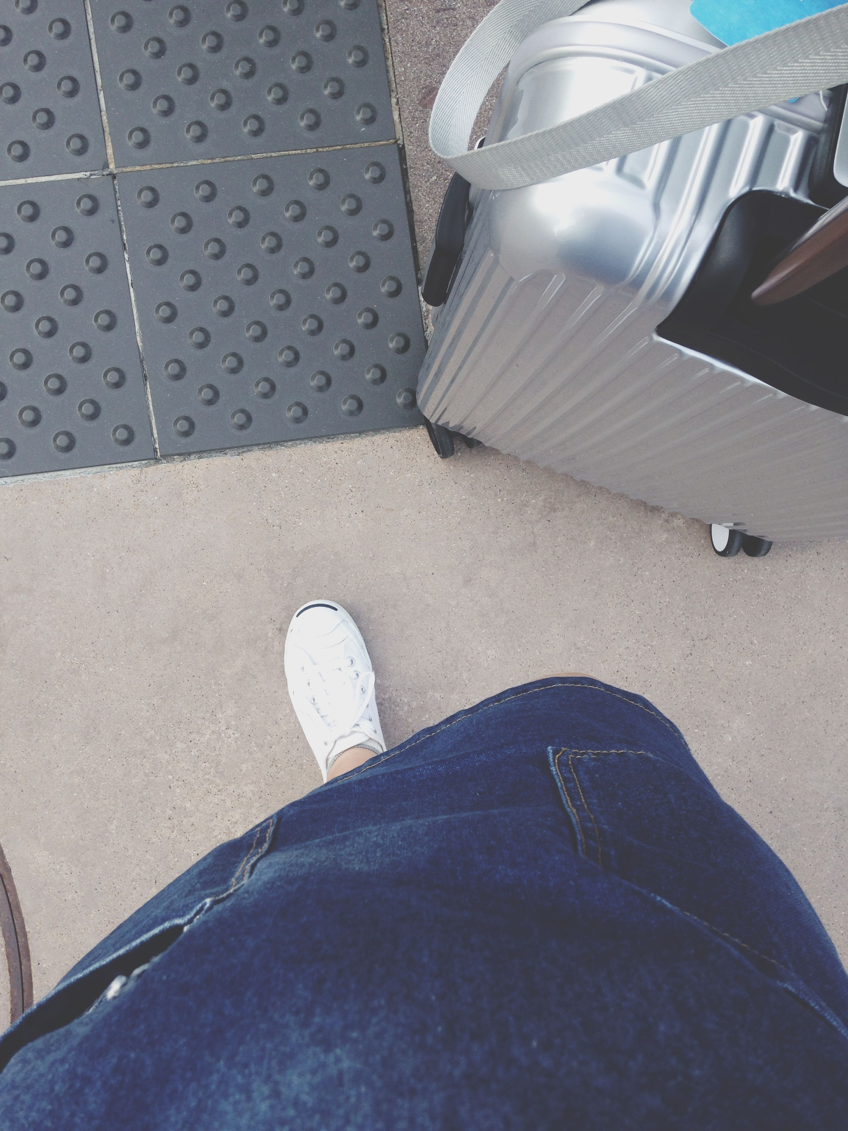 low section, person, shoe, personal perspective, lifestyles, high angle view, leisure activity, jeans, men, footwear, human foot, part of, sitting, transportation, relaxation, unrecognizable person, standing