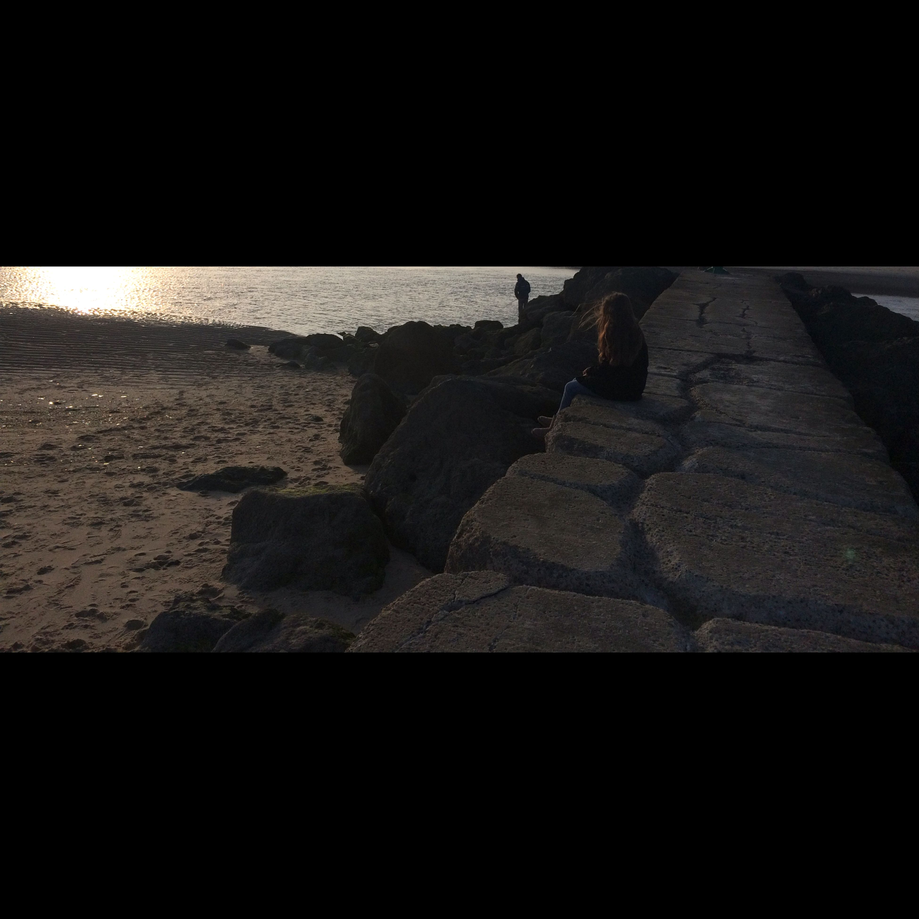 shadow, transfer print, sunlight, auto post production filter, high angle view, water, sea, silhouette, beach, outdoors, day, nature, rock - object, copy space, dark, no people, tranquility, textured, vignette, railing