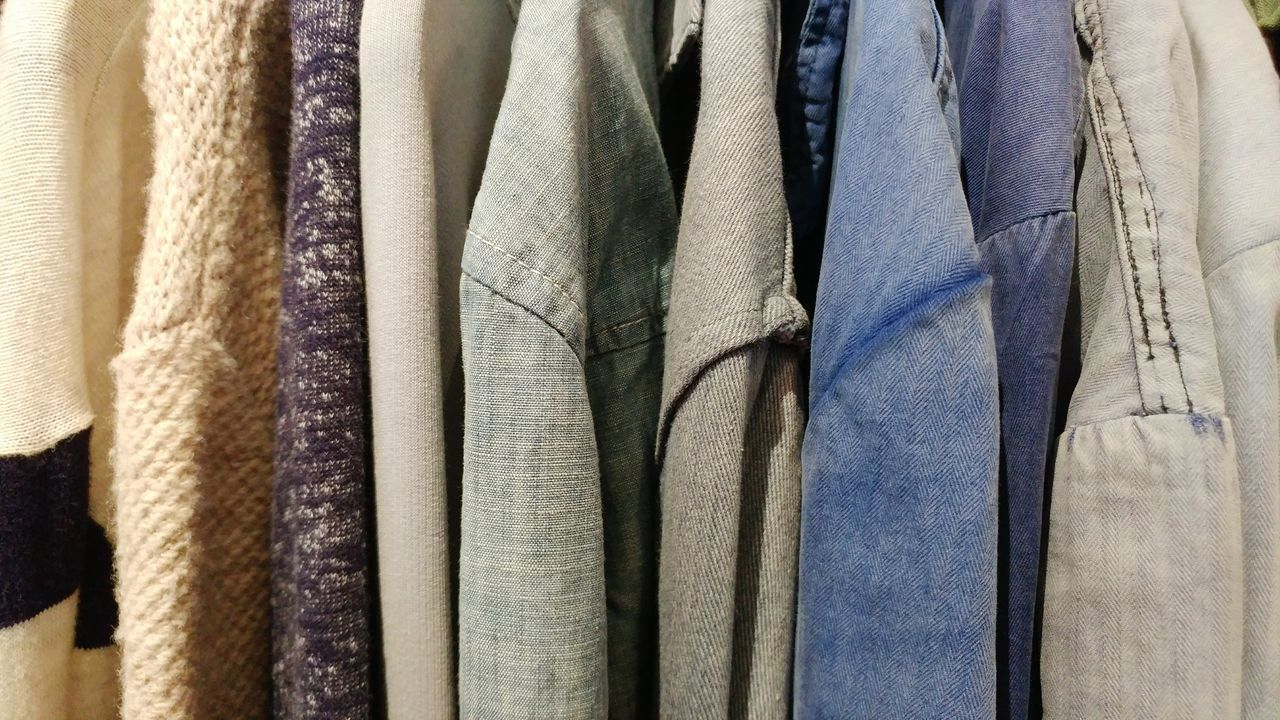 chambray, denim, knit, and other fabric textures on long sleeve shirts. Denim Chambray Knitted  Fashion Textures Shopping Time Textile Backgrounds Curtain Full Frame Fabric Variation Indoors  No People For Sale Hanging Close-up