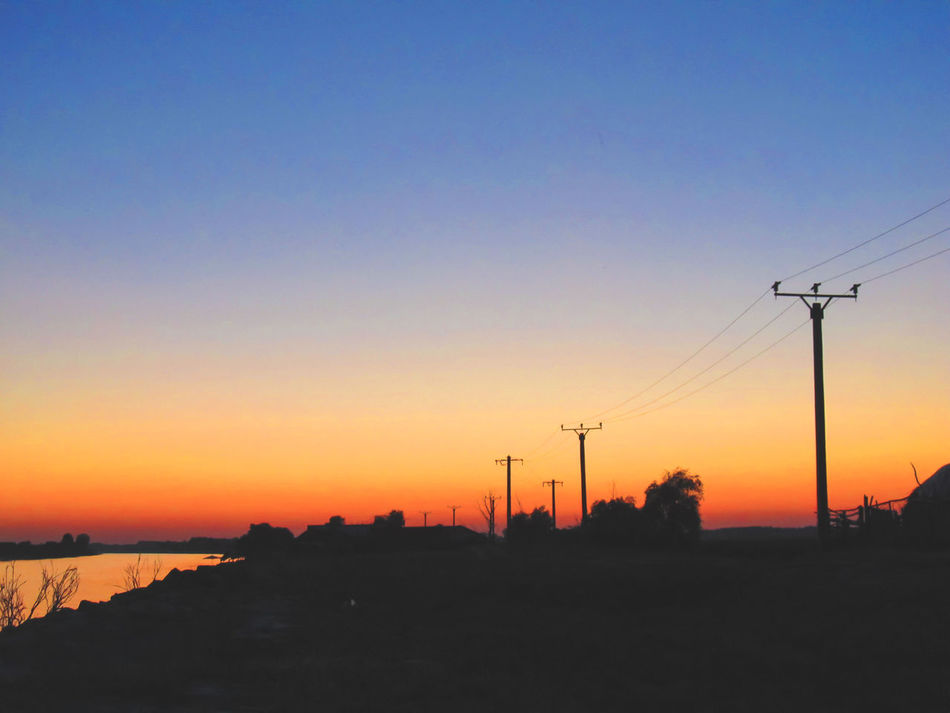 Beauty In Nature Cable Clear Sky Connection Day Electricity  Electricity Pylon Nature No People Outdoors Power Line  Power Supply Scenics Silhouette Sky Sunset Technology Telephone Pole Tranquil Scene Tranquility Water