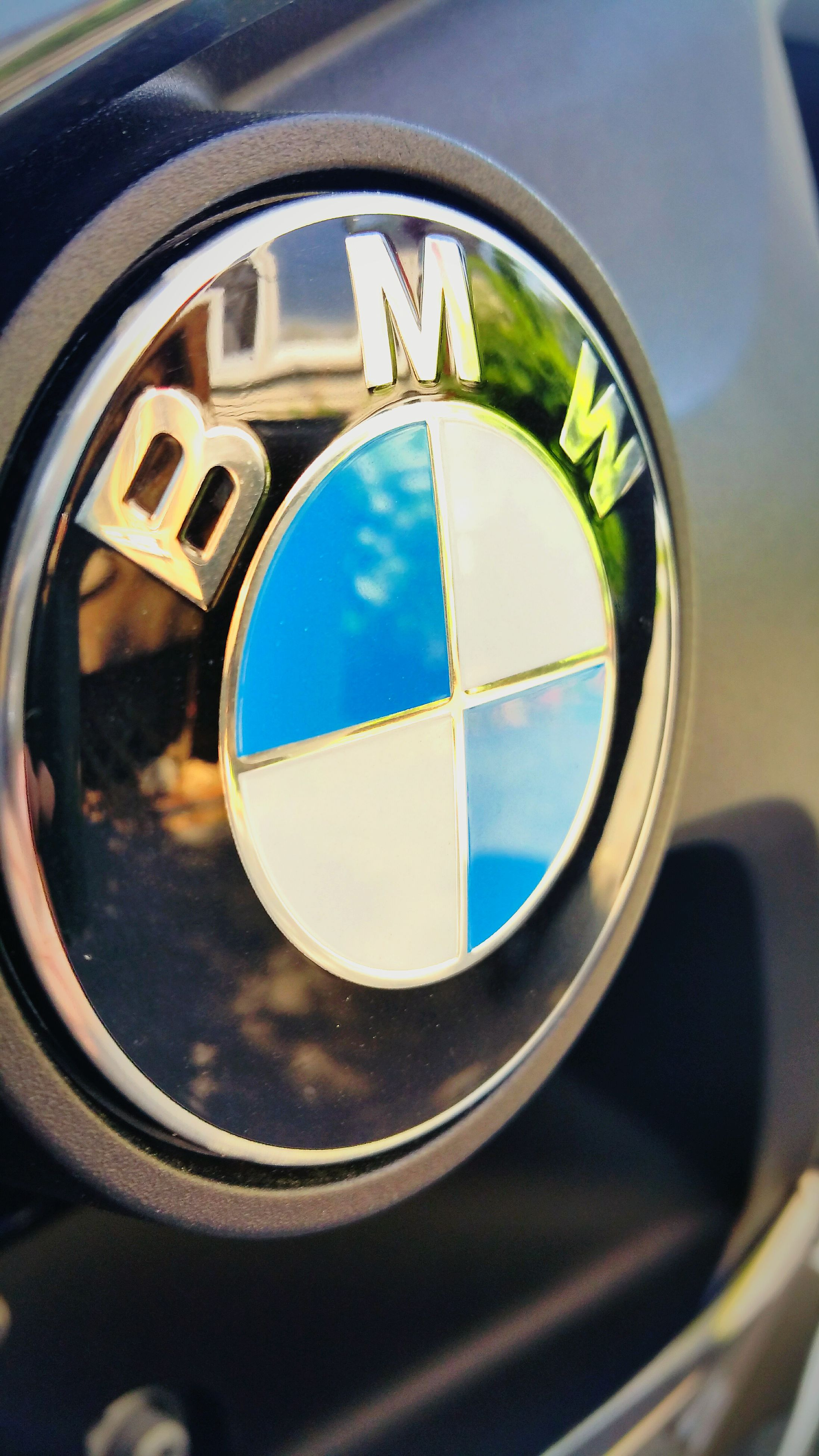 transportation, mode of transport, circle, close-up, reflection, land vehicle, car, part of, side-view mirror, sky, vehicle interior, glass - material, geometric shape, cropped, window, transparent, blue, day, no people, car interior