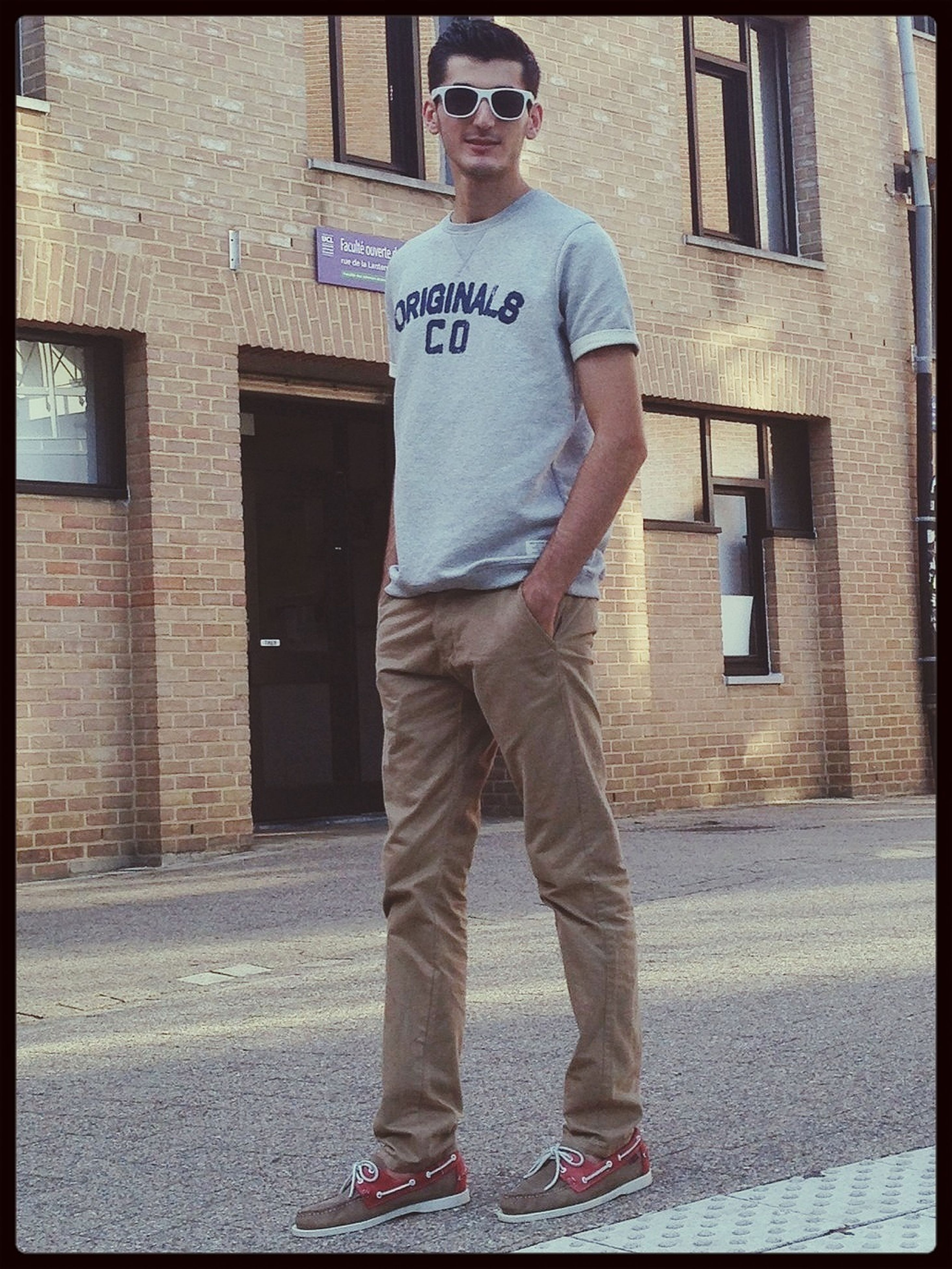 transfer print, building exterior, auto post production filter, architecture, built structure, lifestyles, standing, casual clothing, full length, street, men, front view, leisure activity, communication, wall - building feature, text, day, walking