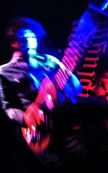 Arts Culture And Entertainment Blurred Motion Disco Lights Guitar Player Illuminated Motion Music Musical Instrument Musical Performance Musician Neon Light Night Nightclub Nightlife Performance Rock Concert