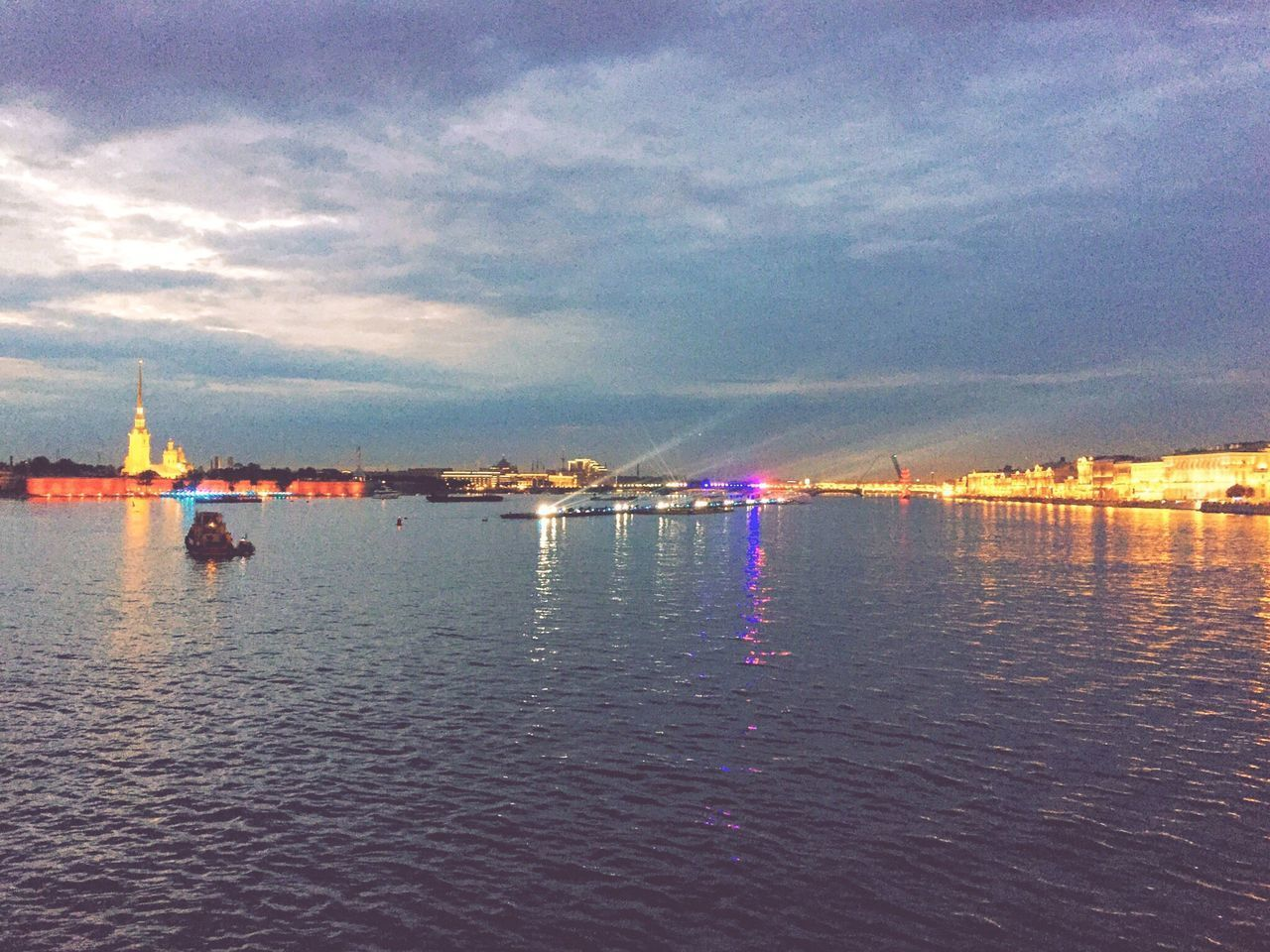 sky, cloud - sky, water, illuminated, outdoors, waterfront, reflection, built structure, sea, architecture, building exterior, nautical vessel, scenics, nature, beauty in nature, no people, travel destinations, sunset, night