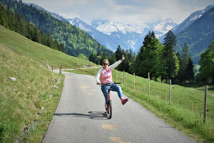 Beauty In Nature Bicycle Cycling Day Full Length Fun Grass Happiness Healthy Lifestyle Leisure Activity Lifestyles Live For The Story Mountain Mountain Range Nature Oberstdorf One Person Outdoors Real People Riding Scenics Sky Smiling Transportation Young Adult