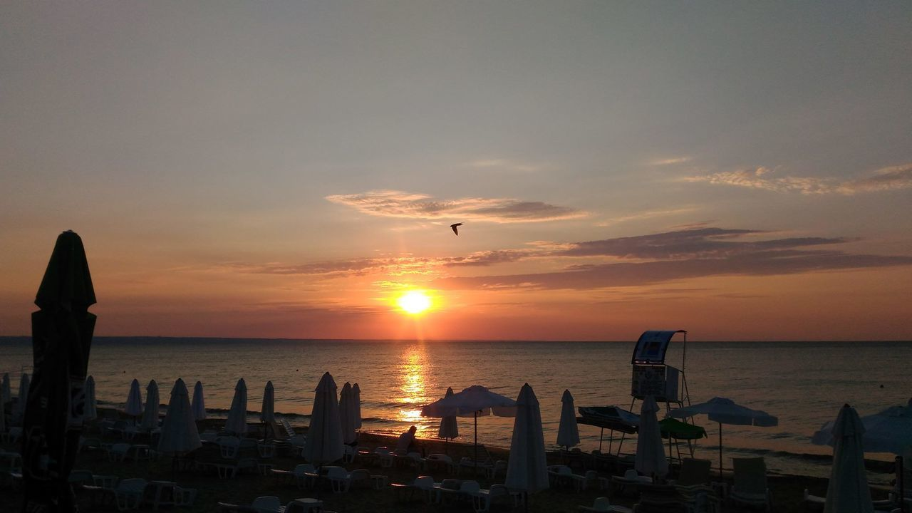 Sunset at Golden Sands Amazing Nature Amazing Sunset Amazing View Awesome Sunset Beach Beauty In Nature Bird Bird On Sky Flying Golden Sands Golden Sands Beach Horizon Over Water Nature Relaxing Moments Relaxing Time Sea Sky Sun Sunset Umbrellas Umbrellas On The Beach Varna Varna Beach Varna Bulgaria Water