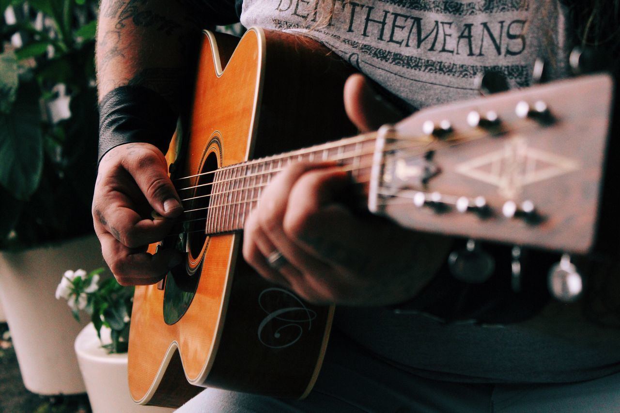 Beautiful stock photos of gitarre, music, guitar, plucking an instrument, midsection