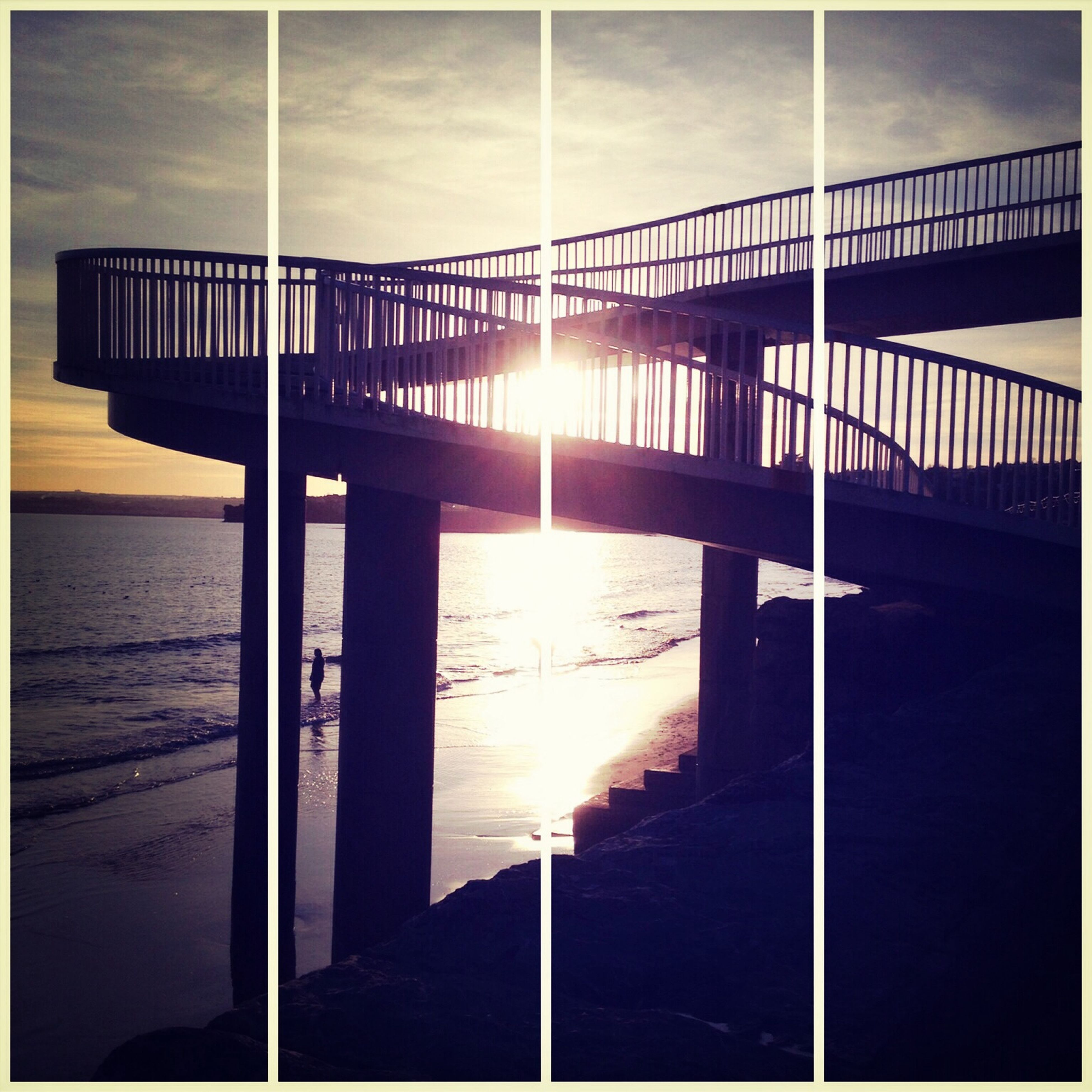 water, sea, built structure, sun, sunset, sunlight, transfer print, architecture, railing, sky, reflection, auto post production filter, sunbeam, pier, silhouette, nature, horizon over water, tranquility, beach, cloud - sky