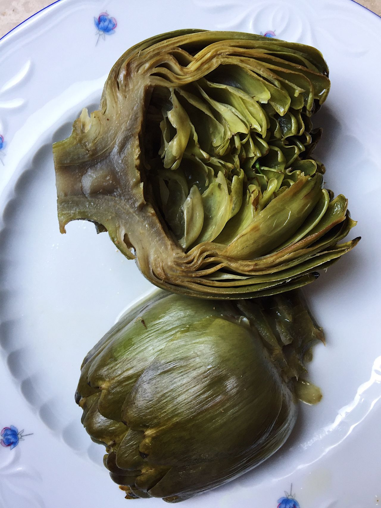 Cooked artichoke is ready to be eaten as a part of a healthy lifestile diet Artichoke Artichokes Boiled Cooked Cooking Diet Food Food Fried Green Growth Healthy Healthy Eating Healthy Lifestyle Home Cooked Home Cooking Leaf Nature Peal Plate Ready To Cook Ready To Eat Vegetable Vegetarian Food