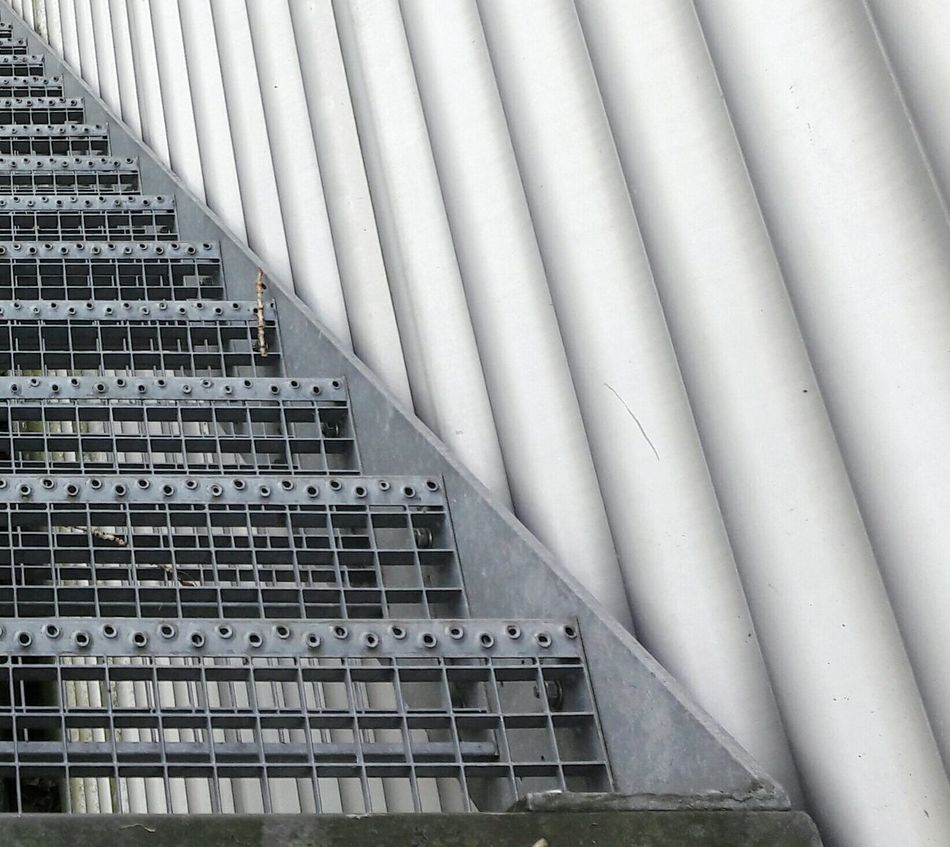 up and down Architecture Building Exterior Industry Built Structure Steel Stairs Stair Façade Facade Detail Facadelovers Architectural Detail Architectural Feature Metal Industry Metal Work Metal Things Facade Love Outdoors No People Modern Stair Treads Patterns Geometric Geometry Pattern Round And Square