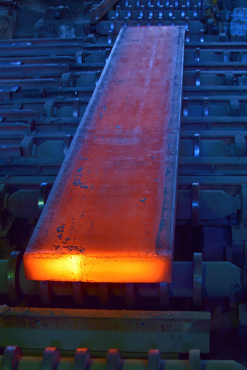 orange color, no people, indoors, industry, metal industry, factory, close-up, day