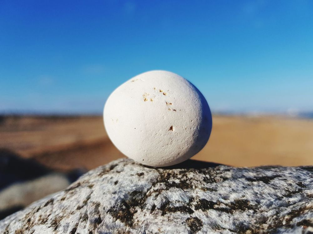 EyeEm Selects Sand Blue Nature Beach Day Tranquility Sky No People Outdoors Close-up Moon Water Astronomy Pebble