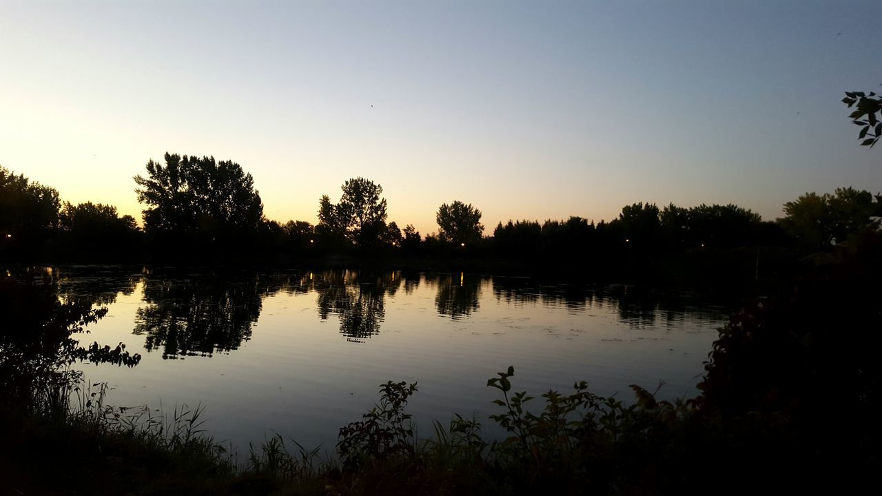 reflection, tree, water, sunset, silhouette, lake, nature, tranquil scene, tranquility, scenics, beauty in nature, outdoors, no people, clear sky, sky, day