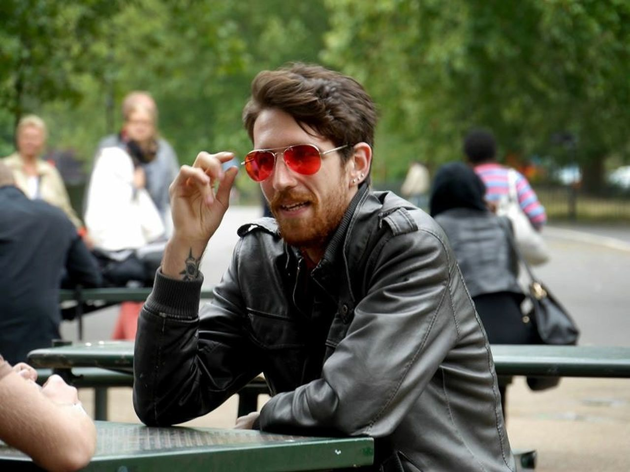 young men, real people, sunglasses, young adult, casual clothing, day, leisure activity, focus on foreground, outdoors, sitting, men, togetherness, only men, adult, adults only, people