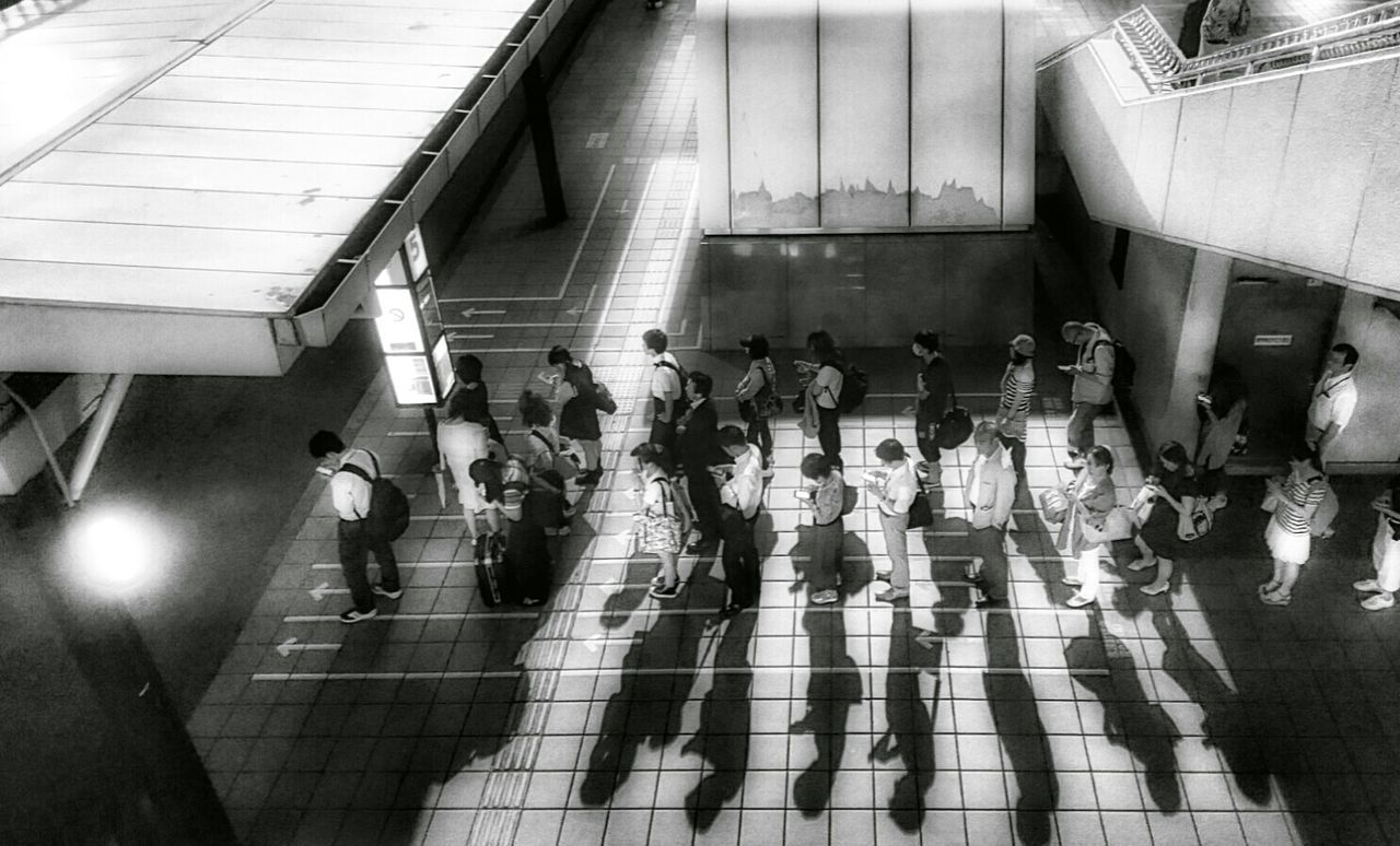 Capture The Moment Bus Station People People Photography Looking Down Urban Lifestyle Light And Shadow Silhouettes Blackandwhite Photography