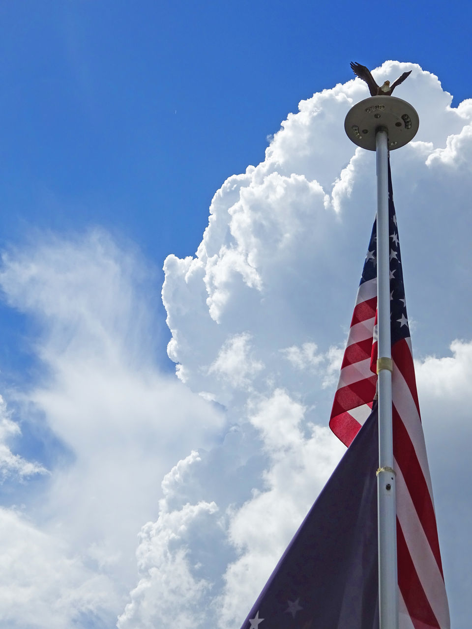 low angle view, cloud - sky, sky, flag, day, no people, outdoors, blue, nature