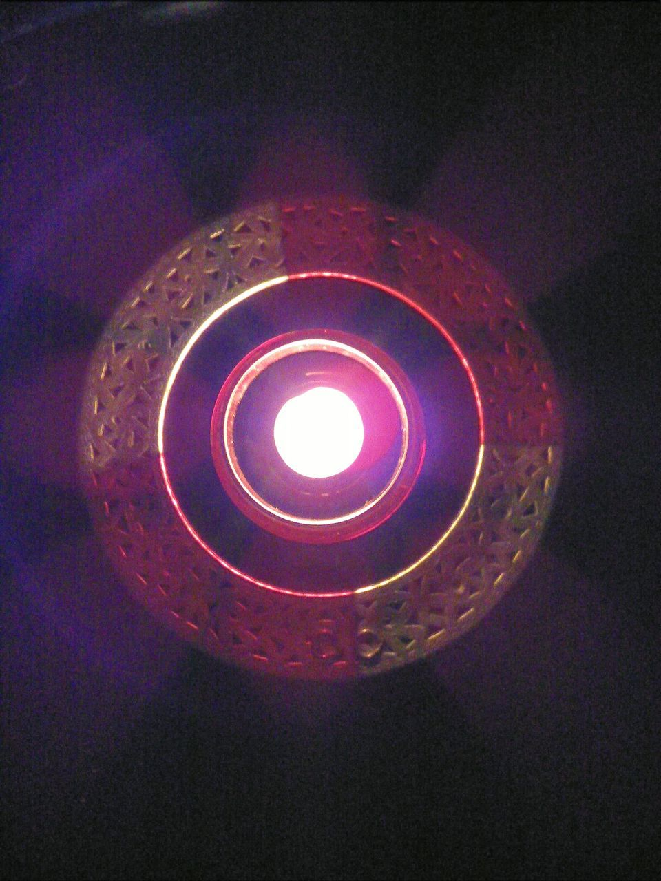 High Angle View Of Burning Candle In Darkroom