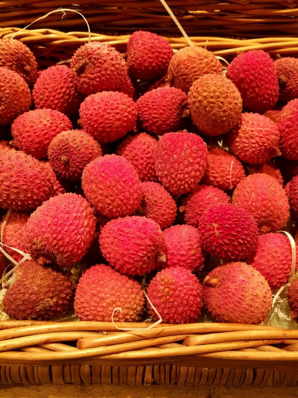 Close-Up Of Lychees In Basket