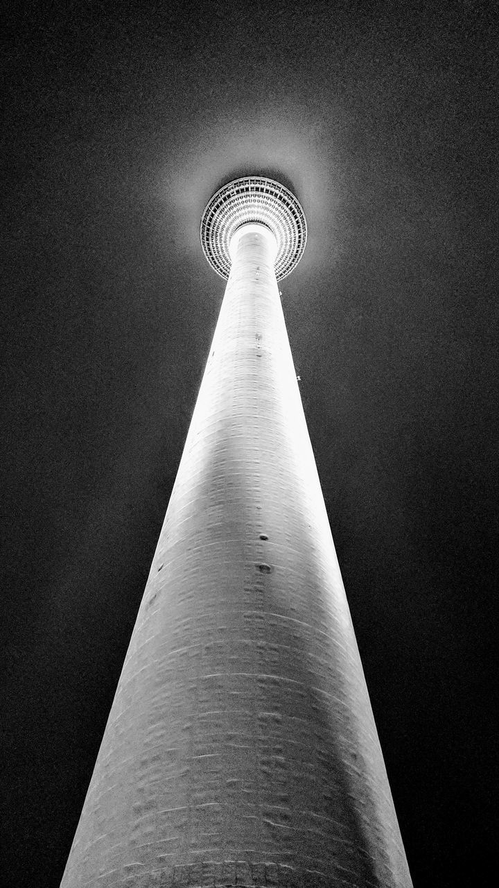 architecture, tall - high, built structure, tower, travel destinations, spire, building exterior, low angle view, tourism, no people, communication, travel, skyscraper, night, modern, city, illuminated, outdoors, sky