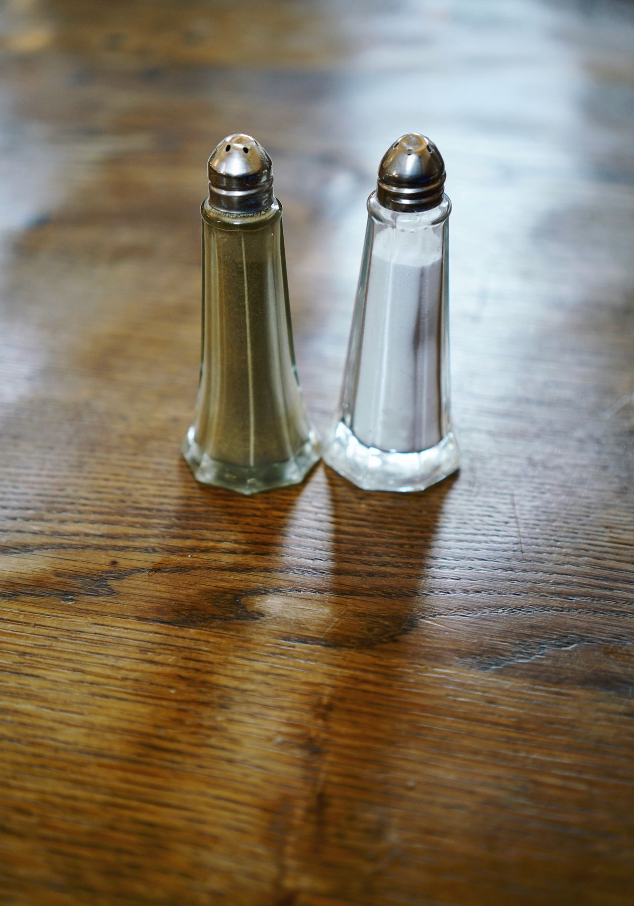 Salt and Pepper on old wood table Pepper Shaker Salt Shaker Pepper - Seasoning Salt - Seasoning Table High Angle View Wood - Material Indoors  Food No People Close-up