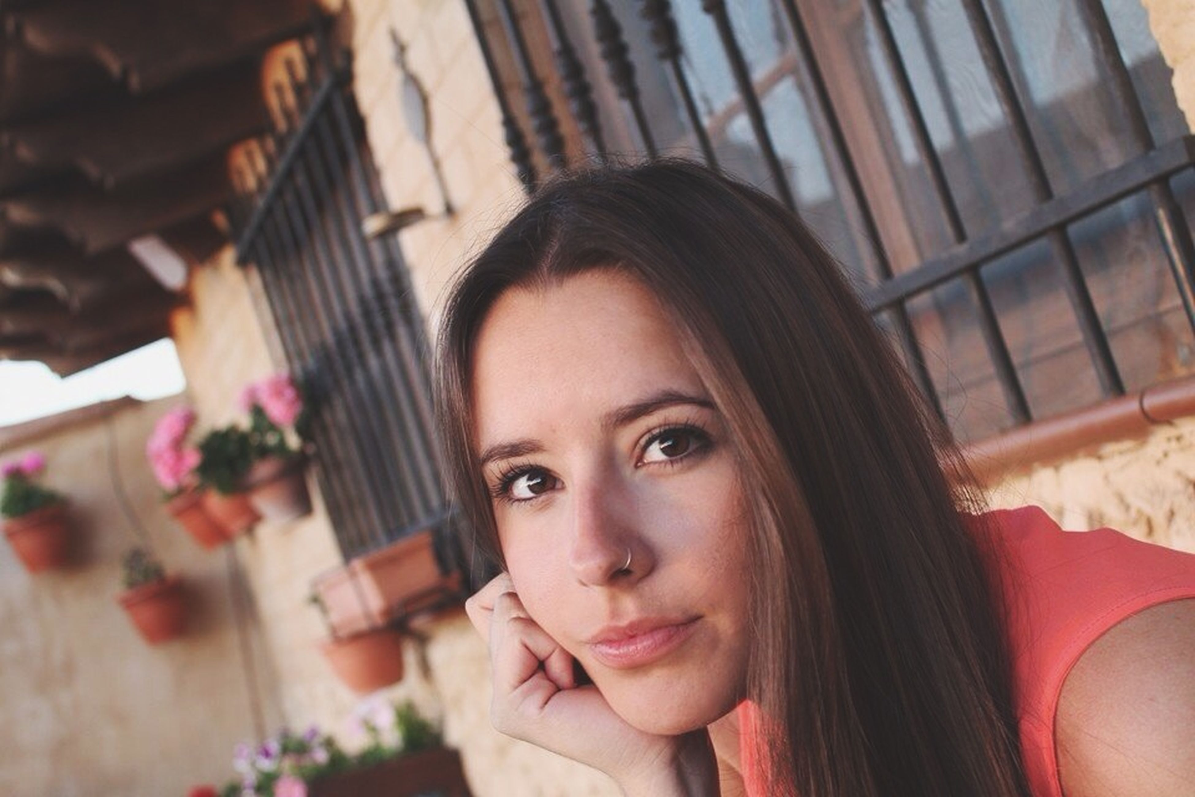 lifestyles, person, headshot, young women, young adult, indoors, portrait, looking at camera, leisure activity, focus on foreground, front view, long hair, head and shoulders, smiling, built structure, close-up, architecture
