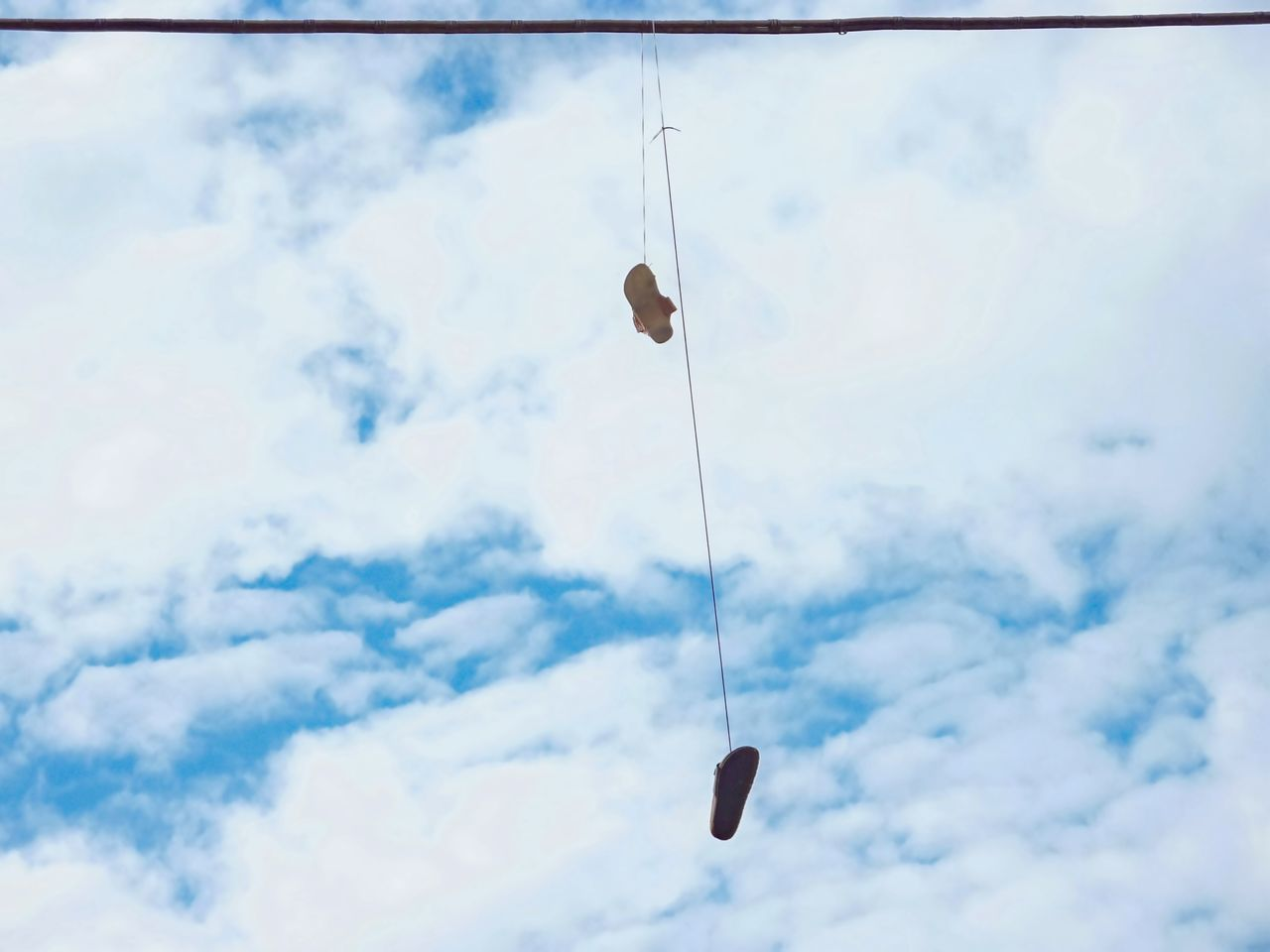 The game of hanging shoes... Cloud - Sky Hanging Hanging Around Hanging Out Hanging Shoe Low Angle View No People Outdoors Rope Shoes Sky Strange Game Streetphotography