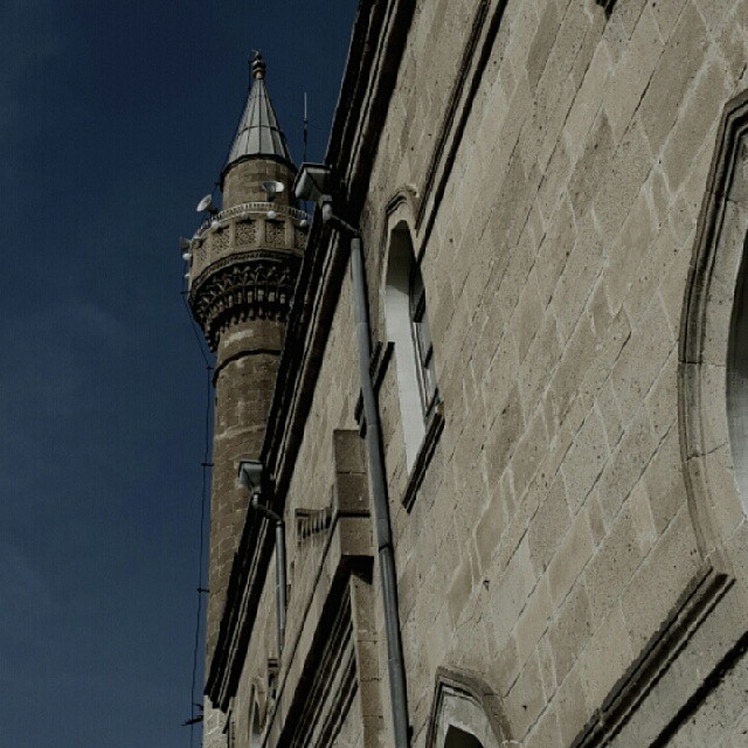 low angle view, architecture, built structure, building exterior, clear sky, tower, blue, sky, famous place, travel destinations, church, tall - high, city, day, no people, religion, capital cities, outdoors, building, place of worship