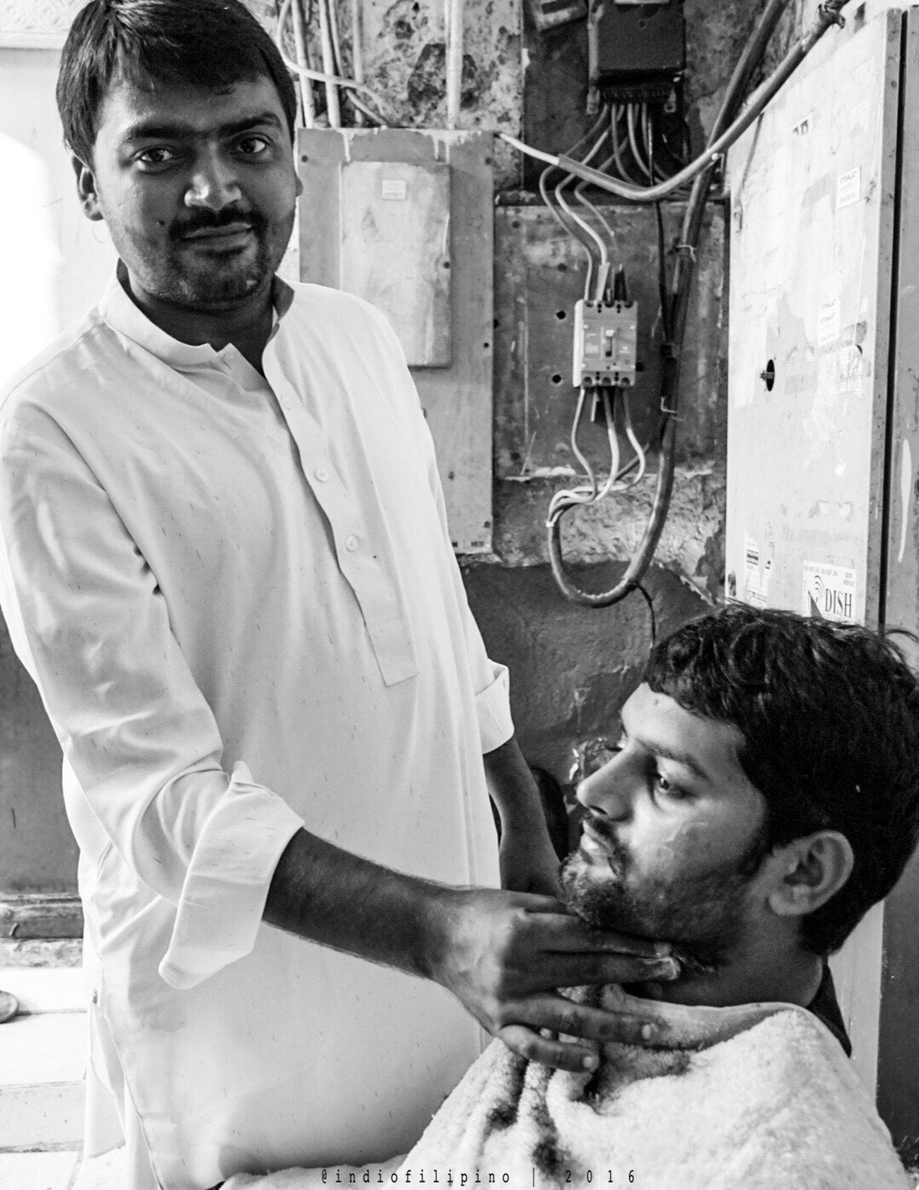 Portrait Looking At Camera Real People Barber People Dailydoseofstreet Streetlife Blackandwhitephotography Streetphotography Exploreuae Liveoutdoors Streetphoto_bw Whynotportraits