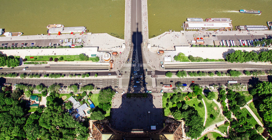 The Eiffel Tower is like a huge sundial in the middle of the city of Paris, its shadow runs like the clock hands of a watch and never stands still. For a brief moment, the shadow stands daily exactly in the middle of the bridge over the Seine. Bridge Built Structure Capital Of France Day Eiffel Tower Eiffeltower From Above  Green Color High Angle View Light And Shadow Natural Light And Shadow Effect Paris Rail Transportation Road Scenery Seine Seine River Shadow Shadow And Light Shadowplay Shadows & Lights Sundial Sunny Top Of The Eiffel Tower View From Above The City Light Flying High Mobility In Mega Cities