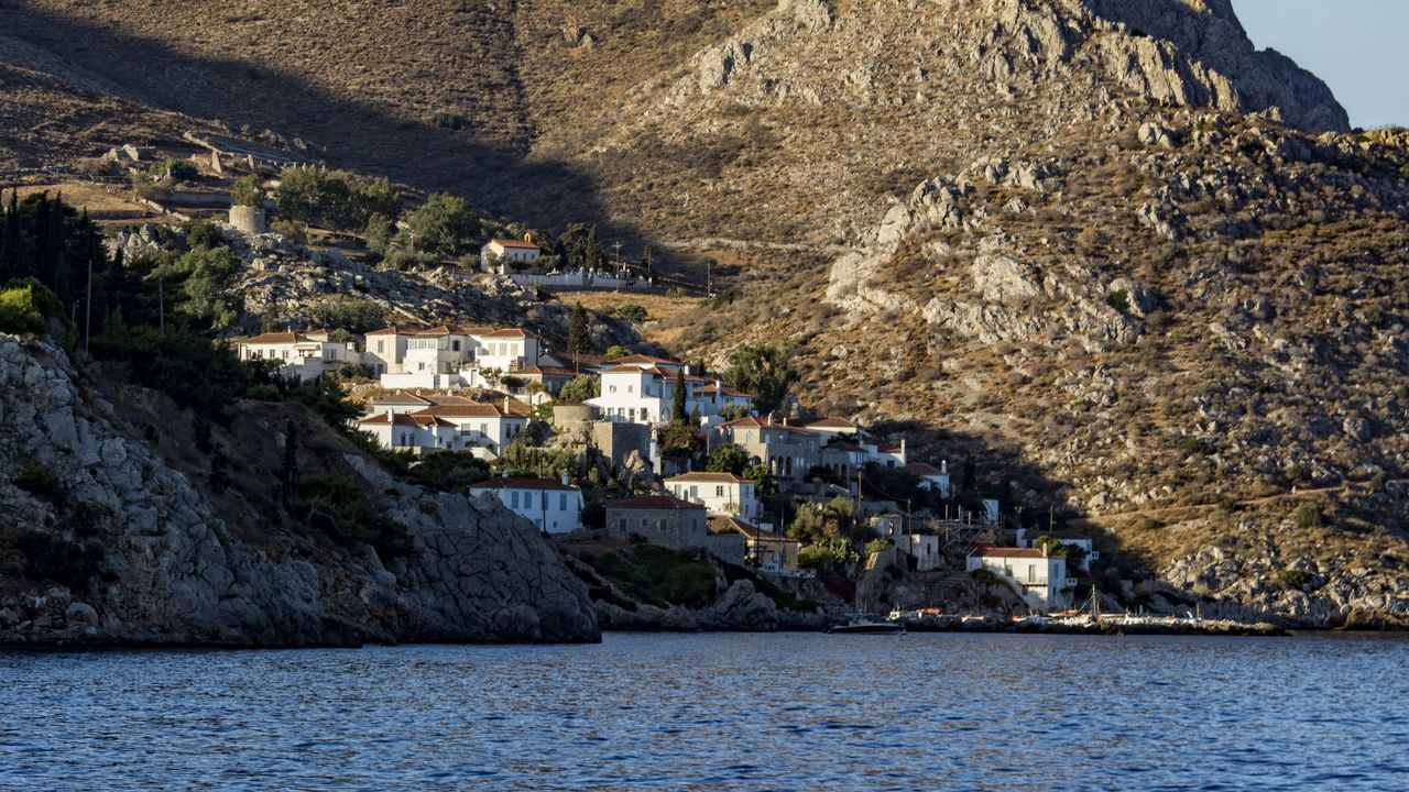 Ydra Buildings Greece Houses Hydra Island Mediterranean Sea Montains And Water  Peloponnese Greece Summertime Sunlight And Shadow Ýdra, Greece