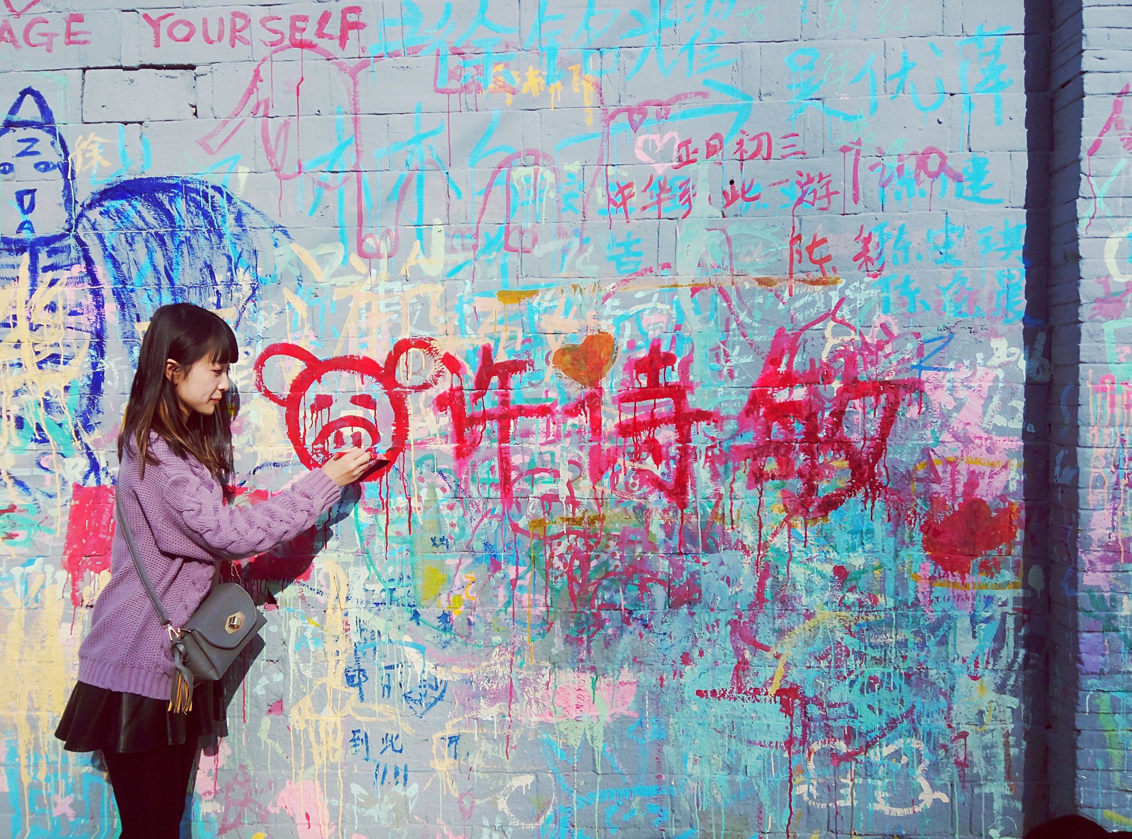 graffiti, wall - building feature, art, text, creativity, art and craft, communication, western script, human representation, wall, built structure, architecture, painting, building exterior, non-western script, multi colored, day, brick wall