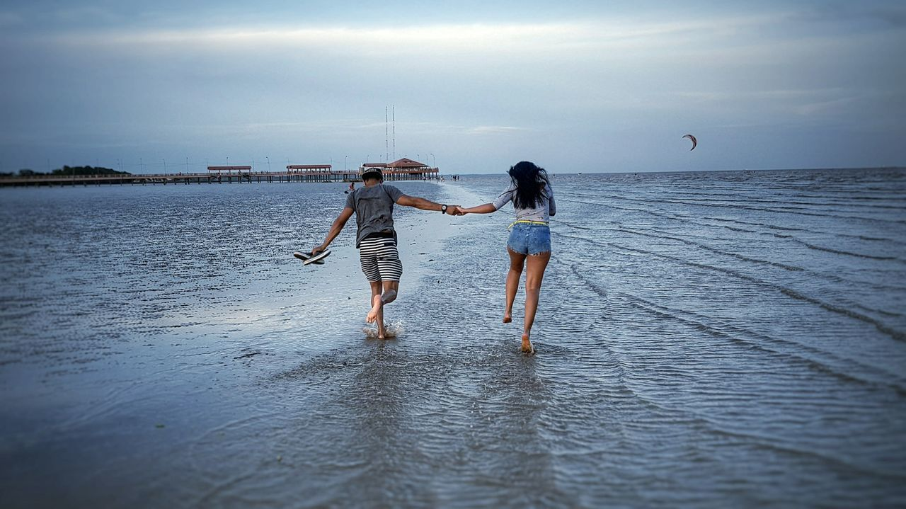 Two People Togetherness Standing Beach Sea Vacations Summer Horizon Over Water People Adult Leisure Activity Bonding Full Length Fun Enjoyment Day Child Sky Young Adult Childhood Love Valentine's Day  Premium Collection Getty Images Bestsellers Live For The Story BYOPaper! The Great Outdoors - 2017 EyeEm Awards EyeEmNewHere Out Of The Box The Great Outdoors - 2017 EyeEm Awards Place Of Heart Sommergefühle EyeEm Selects 100 Days Of Summer