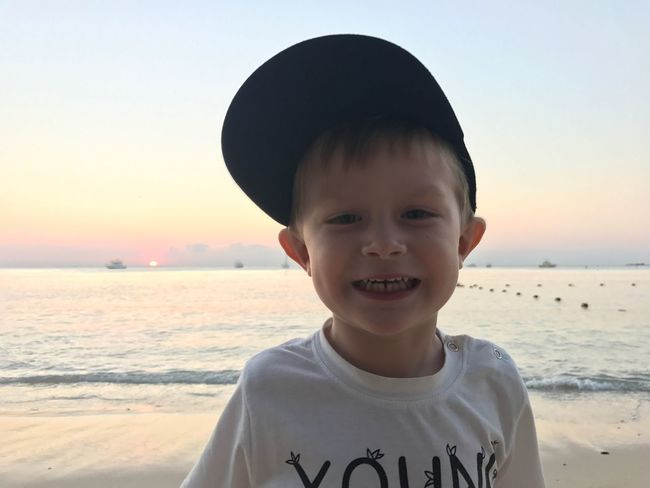EyeEm Selects Real People Beach Sea Childhood Boys One Person Sand Outdoors Front View Looking At Camera Leisure Activity Lifestyles Portrait Sunset Nature Headshot Water Sky Day Horizon Over Water Gerrits