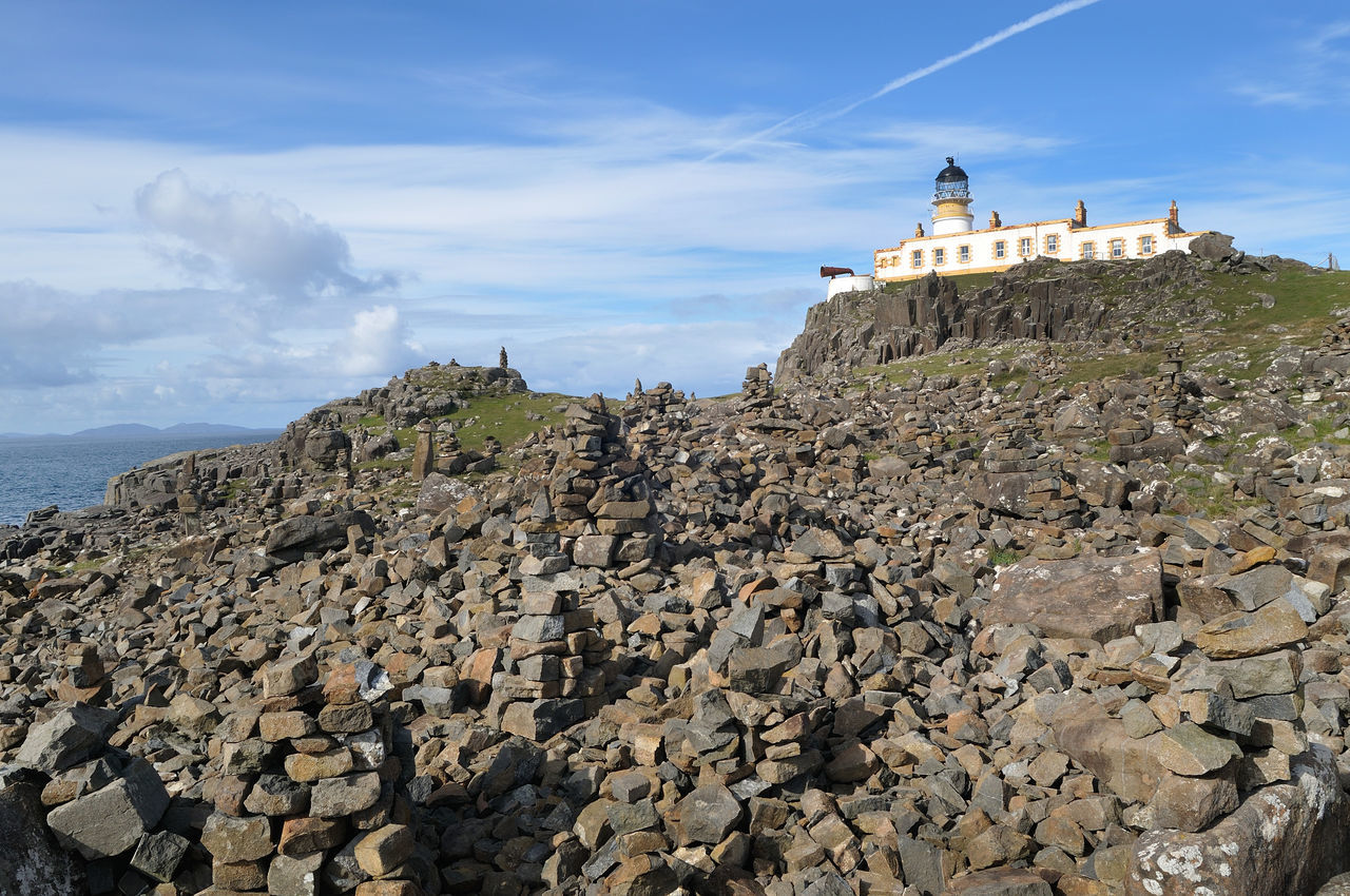 Neist Point Lighthouse, Isle of Skye. In the foreground are the many cairns built by visitors to the point. Cloud - Sky Landscape Lighthouse Neist Point Non-urban Scene Rock Formation Rocky Scotland Sky Skye Stone Stone - Object