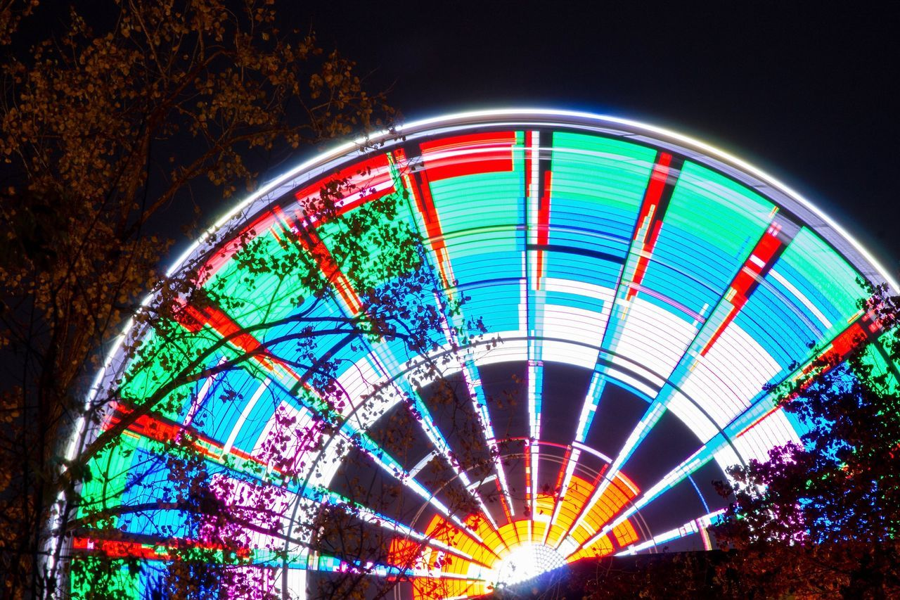 Illuminated Night Low Angle View Amusement Park Ride Ferris Wheel Multi Colored No People Amusement Park Sky Outdoors Architecture Skywheel Pigeon Forge Tennessee Colors