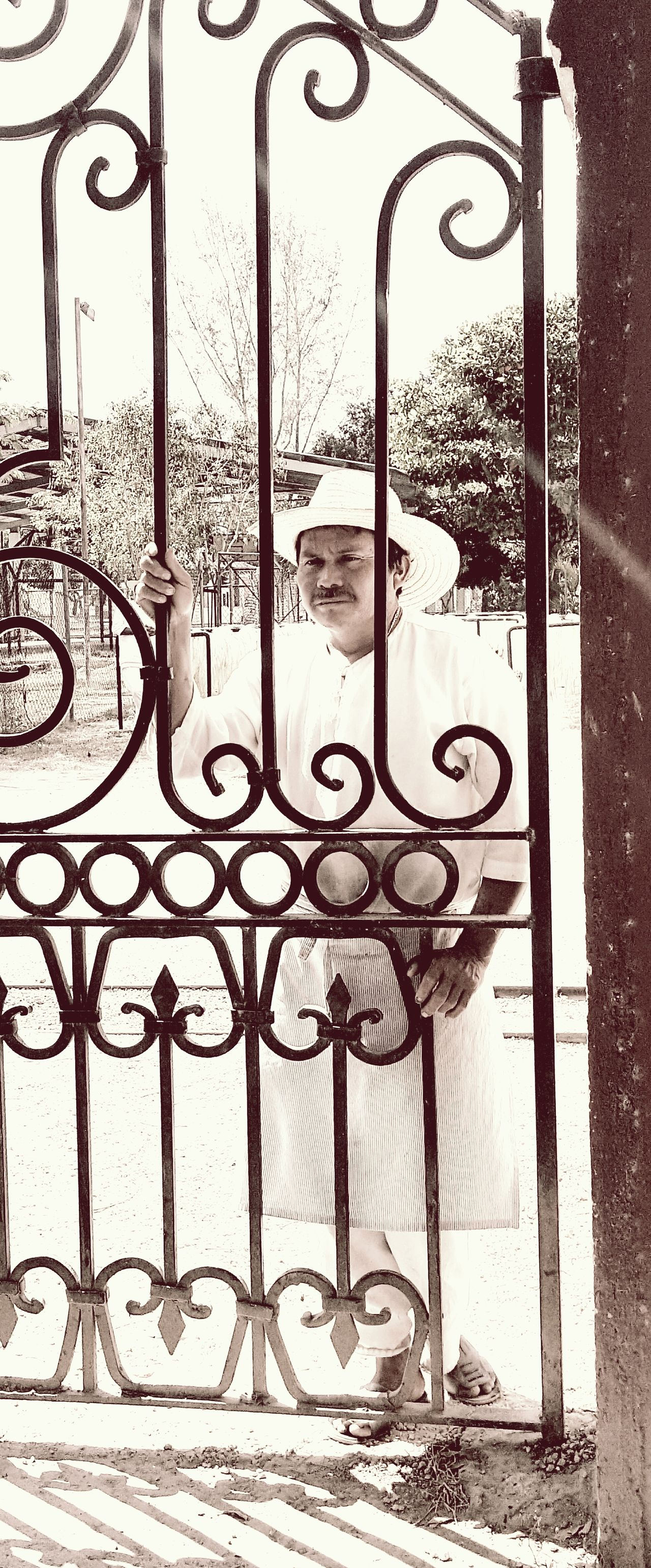 Day Iron Gate Metal Gate Mexican Far Mexican Man Mexican Peasan Mexican Work Old Mexico One Person Outdoors People Real People Sepia Photography