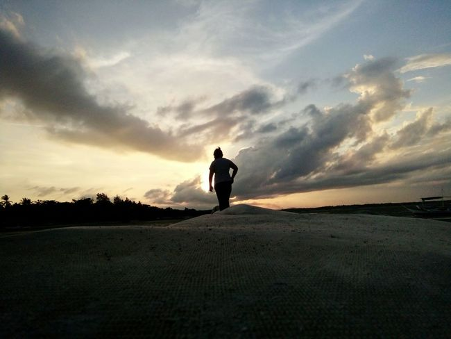 Adventure Silhouette Men Standing Rear View Leisure Activity Landscape Full Length Sky Scenics Tranquil Scene Getting Away From It All Tranquility Cloud - Sky Solitude Nature Remote Outdoors Escapism Day Beauty In Nature